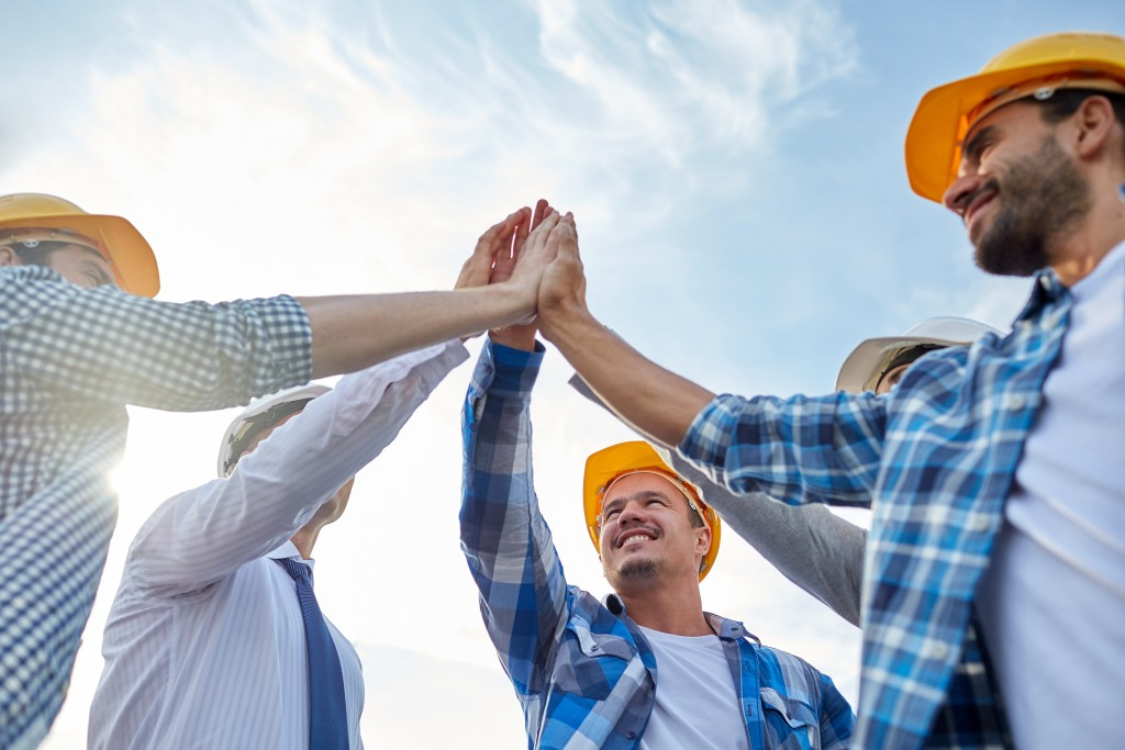 Builders wearing safety hats