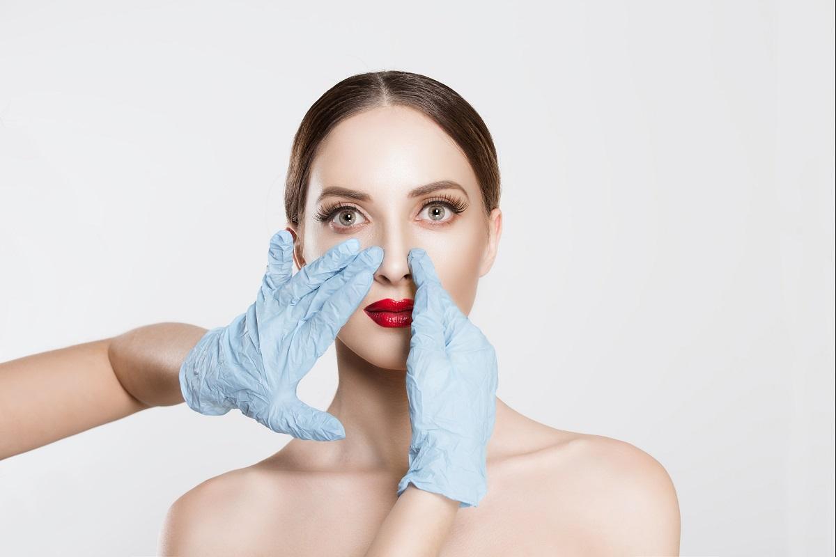 woman getting prepped for a nose surgery