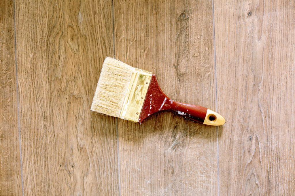 paintbrush on wooden floor
