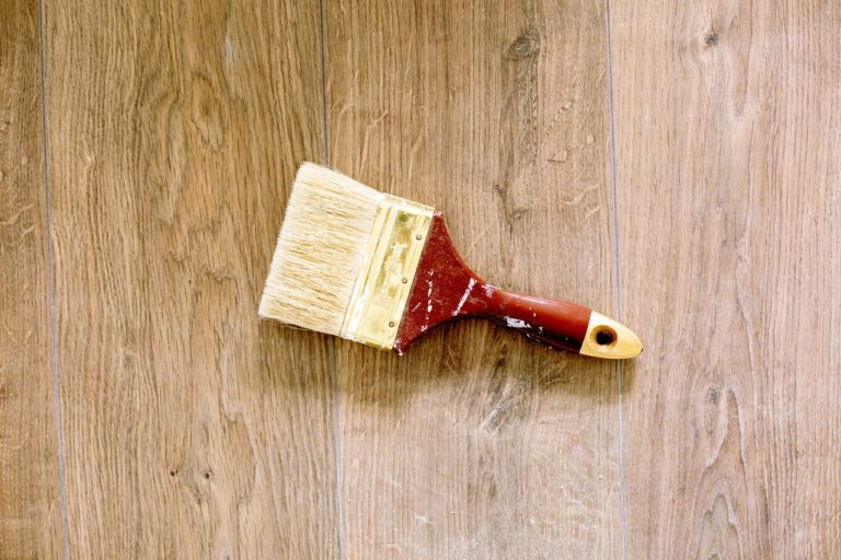 paintbrush on wooden floor