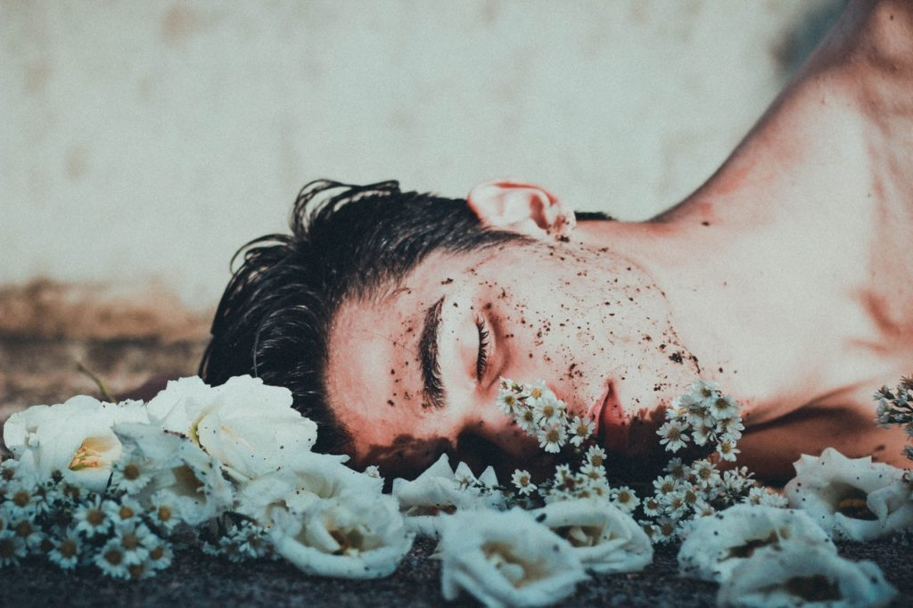 man laying in dirt