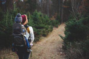 parent and kid hiking