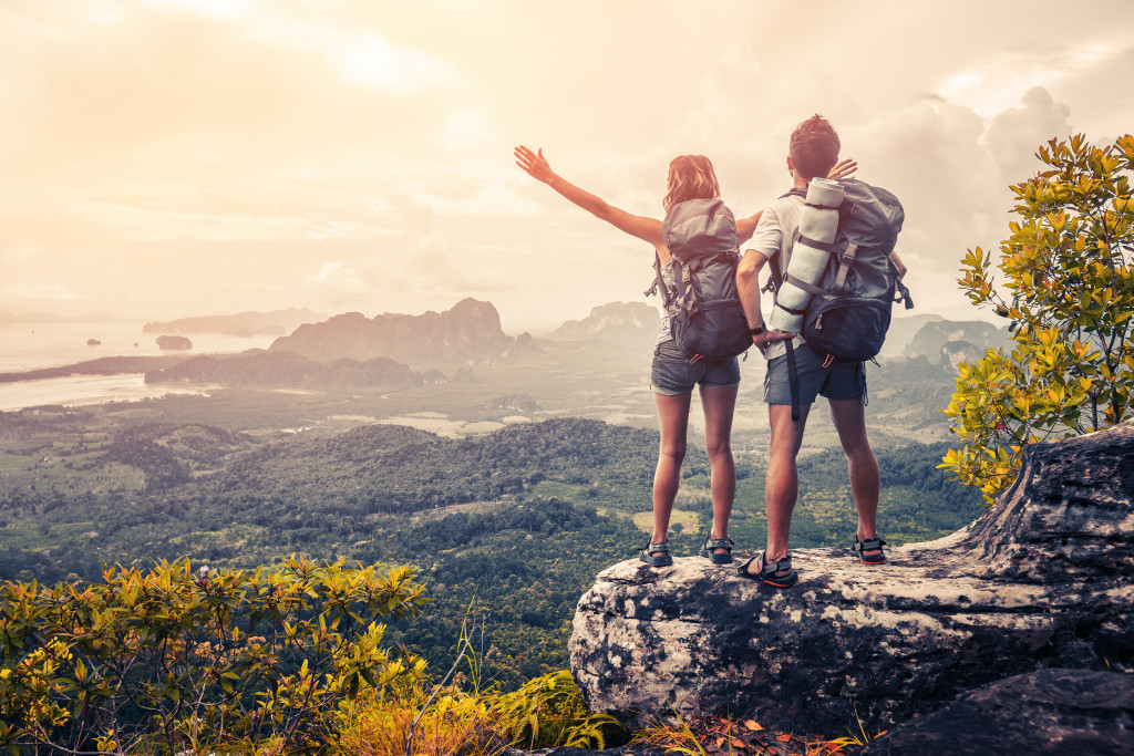 couple standing on top of the mountain